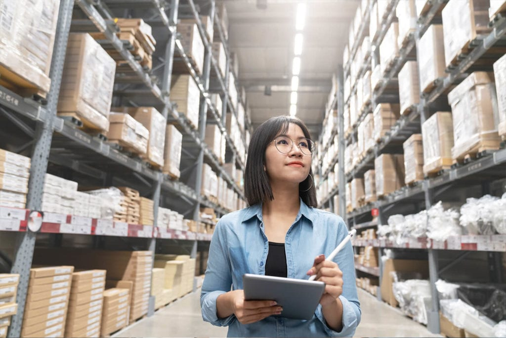 Female taking inventory in a warehouse